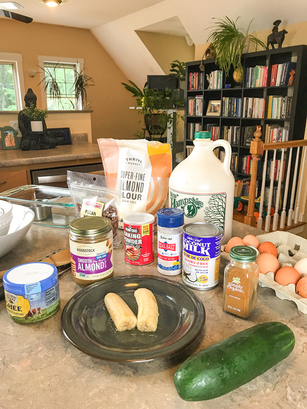 kitchen tools and ingredients needed for cinnamon swirl zucchini bread arranged on kitchen counter